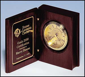 bc69 - Rosewood stained book clock gold-spun dial, three hand movement