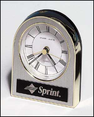 bc93 - Gold, silver and black plastic clock, white dial, alarm movement